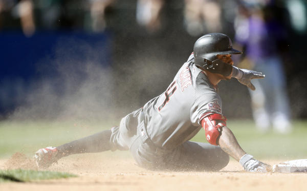 Slide 1 of 18: Arizona Diamondbacks' Ketel Marte slides safely into second base with an RBI-double off Colorado Rockies relief pitcher Yency Almonte in the seventh inning of a baseball game Thursday, Sept. 13, 2018, in Denver. ()