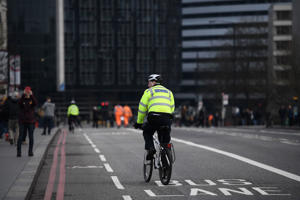 LONDON, ENGLAND - MARCH 23:  Police cycle over Westminster Bridge as it is opened to the public on March 23, 2017 in London, England.  Four people have been killed and around 40 people injured following yesterday's attack by the Houses of Parliament in Westminster.  (Photo by Carl Court/Getty Images)