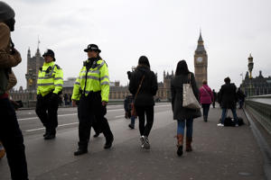 LONDON, ENGLAND - MARCH 23:  Police walk over Westminster Bridge as it is opened to the public on March 23, 2017 in London, England.  Four people have been killed and around 40 people injured following yesterday's attack by the Houses of Parliament in Westminster.  (Photo by Carl Court/Getty Images)