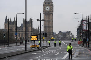 LONDON, ENGLAND - MARCH 23:  Police officers stand on Westminster Bridge as it is closed following yesterday's attack. on March 23, 2017 in London, England. Four people have been killed and around 40 people injured following yesterday's attack by the Houses of Parliament in Westminster.  (Photo by Carl Court/Getty Images)