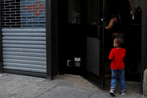 A child is seen entering the Cayuga Center, which provides foster care and other services to immigrant children separated from their families in New York City, U.S., June 20, 2018. REUTERS/Brendan McDermid