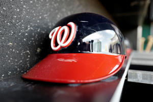 A Washington Nationals helmet sits in the dugout prior to a baseball game between the New York Mets and Washington Nationals, Saturday, August 26, 2017, in Washington. (AP Photo/Mark Tenally)