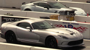 a car parked in a parking lot: Dodge Viper Races Chevy Corvette Grand Sport