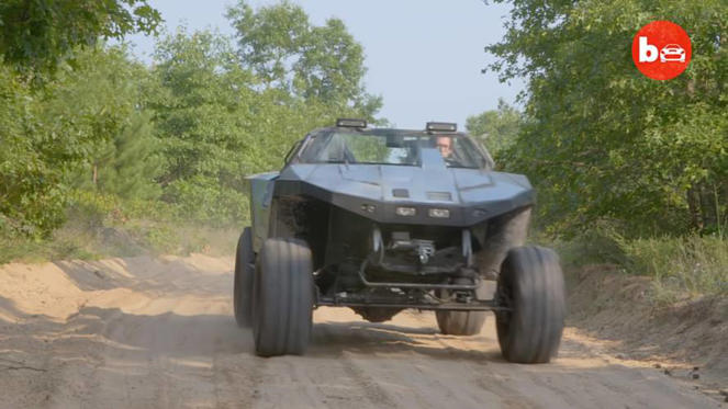 a truck driving down a dirt road: Halo Warthog Replica