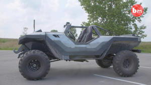 a tractor in front of a car: Halo Warthog Replica
