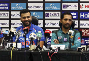 CAPTION: Captains of six cricket teams participating in Asia Cup, from left, Hong Kong's Anshy Rath, Sri Lanka's Angelo Mathews, India's Rohit Sharma, Pakistan's Sarfraz Ahmed, Bangladesh's Mashrafe Mortaza and Afghanistan's Asghar Afghan interact with journalists during a press conference at Dubai International Cricket Stadium in Dubai, United Arab Emirates, Friday, Sept. 14, 2018. (AP Photo/Aijaz Rahi)