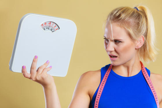 Slide 1 of 13: Fit fitness woman with scale. Frustrated angry blonde girl holding weight scales. Time for slimming weightloss, diet and healthy lifestyles concept