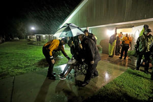 Members of the Nebraska Task Force 1 urban search and rescue team help load an elderly resident onto a bus as they evacuate an assisted living facility to a church as a precaution against potential flooding the city could see from tropical storm Florence in Fayetteville, N.C., Saturday, Sept. 15, 2018.