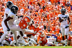 CLEMSON, SC - SEPTEMBER 15: Running back Travis Etienne #9 of the Clemson Tigers rushes for a touchdown against the Georgia Southern Eagles during the football game at Clemson Memorial Stadium on September 15, 2018 in Clemson, South Carolina.