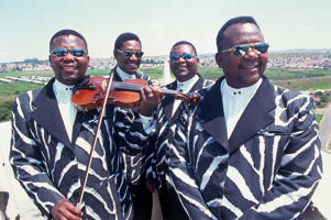 2002. African classical jazz group, The Soweto String Quartet emerged during the 80's around the nucleus of the three Khamese brothers, violinists Sandile and Thami and cellist, Reuben. They formed in 1989 at the Madimba School of Music after being joined by Mahkhonsini Mnguni on viola.