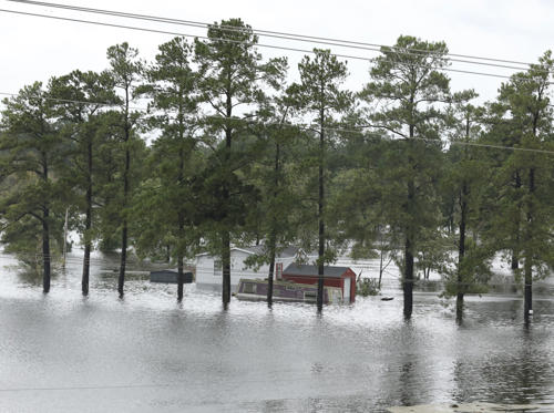 Slide 1 of 72: TOPSHOT - Flooding is seen near Interstate Highway 95 in Lumberton, North Carolina on September 16, 2018. - A killer storm that left up to 13 people dead weakened to a tropical depression on Sunday, but US authorities  warned the devastation it caused -- including catastrophic flooding -- is far from over.Most of the fatalities from Florence, which made landfall Friday as a Category 1 hurricane, have occurred in North Carolina, where officials confirmed eight victims. They included three who died 'due to flash flooding and swift water on roadways,' the Duplin County Sheriff's Office reported. (Photo by Alex EDELMAN / AFP)        (Photo credit should read ALEX EDELMAN/AFP/Getty Images)