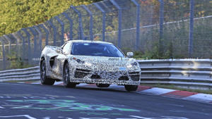 a car driving through a fence: Mid-engined Chevy Corvette C8 spy photo