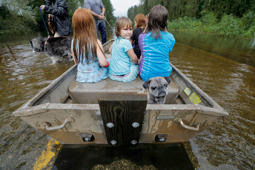 Iva Williamson, 4, peers behind her as she joins neighbors and pets in fleeing rising flood waters in the aftermath of Hurricane Florence in Leland, North Carolina, U.S., September 16, 2018.