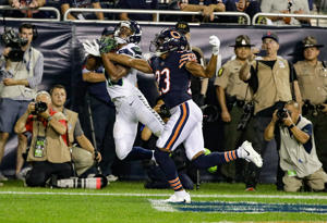 Seahawks wide receiver Tyler Lockett (16) makes a touchdown reception against Bears defensive back Kyle Fuller (23) on Sept. 17, in Chicago. The Bears won 24-17.