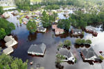 Houses sit in floodwater caused by Hurricane Florence, in this aerial picture, in Lumberton, North Carolina, U.S. September 17, 2018. REUTERS/Jason Miczek