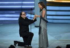 Glenn Weiss (L), winner of the Outstanding Directing for a Variety Special award for 'The Oscars,' proposes marriage to Jan Svendsen onstage during the 70th Emmy Awards at the Microsoft Theatre in Los Angeles, California on September 17, 2018.