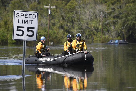 Slide 1 of 110: LUMBERTON, NC - SEPTEMBER 18: Members of Colorado Task Force 1 sweep a rural area, by boat, flooded by Hurricane Florence on September 18, 2018 in Lumberton, North Carolina. (Photo by RJ Sangosti/The Denver Post via Getty Images)