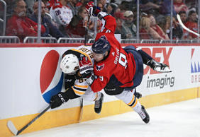 WASHINGTON, DC - SEPTEMBER 18: Dmitry Orlov #9 of the Washington Capitals collides with Anton Blidh #81 of the Boston Bruins during the third period of a preseason NHL game at Capital One Arena on September 18, 2018 in Washington, DC. (Photo by Patrick Smith/Getty Images)