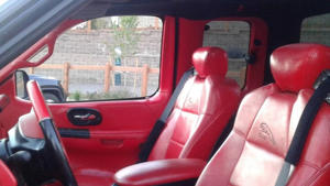 a red car: Custom Jaguar Ford F-150