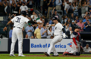 NEW YORK, NY - SEPTEMBER 18:  Christian Vazquez #7 of the Boston Red Sox looks on as Neil Walker #14 of the New York Yankees celebrates his seventh inning three run home run with teammate Aaron Hicks #31 at Yankee Stadium on September 18, 2018 in the Bronx borough of New York City.  (Photo by Jim McIsaac/Getty Images)