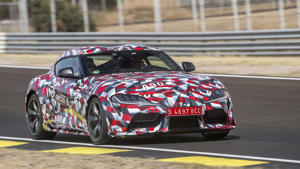 a car driving on a race track: Toyota Supra Prototype