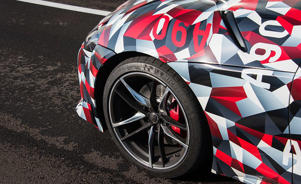 a red white and blue umbrella: The 2020 Supra Proves Toyota Hasn't Forgotten How to Make a Sports Car