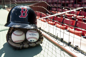 BOSTON, MA - APRIL 26: In this photo illustration, a Boston Red Sox helmet, baseball glove, and baseballs are shown April 26, 2018 at Fenway Park in Boston, Massachusetts. (Photo Illustration by Billie Weiss/Boston Red Sox/Getty Images)