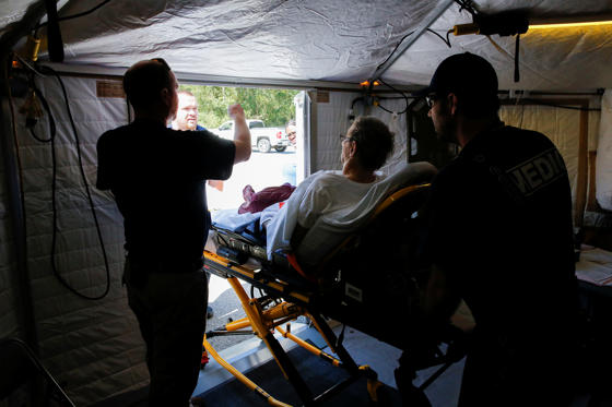 Slide 2 of 106: A man is transported to another hospital by Members of the Mobile Disaster Hospital in the aftermath of Hurricane Florence, now downgraded to a tropical depression in Kinston, North Carolina, U.S., September 19, 2018. REUTERS/Eduardo Munoz