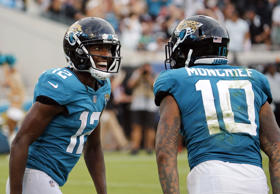 Jacksonville Jaguars wide receiver Dede Westbrook (12) celebrates his 61-yard touchdown against the New England Patriots with teammate wide receiver Donte Moncrief (10) during the second half of an NFL football game, Sunday, Sept. 16, 2018, in Jacksonville, Fla. (AP Photo/Stephen B. Morton)