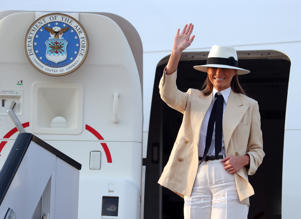U.S. first lady Melania Trump waves as she prepares to depart Cairo, Egypt, October 6, 2018.