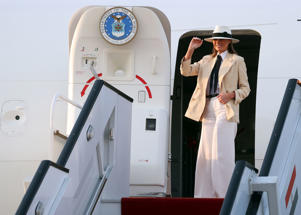 U.S. first lady Melania Trump waves as she prepares to depart Cairo, Egypt, October 6, 2018. REUTERS/Carlo Allegri