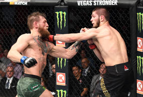 LAS VEGAS, NV - OCTOBER 06: Conor McGregor of Ireland and Khabib Nurmagomedov of Russia trade punches in their UFC lightweight championship bout during the UFC 229 event inside T-Mobile Arena on October 6, 2018 in Las Vegas, Nevada. (Photo by Josh Hedges/Zuffa LLC/Zuffa LLC)