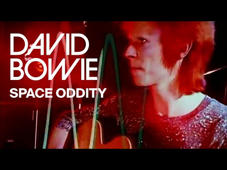 a person holding a sign: Official video for Space Oddity by David Bowie.  Stream the David Bowie greatest hits here ▶ https://RhinoUK.lnk.to/ThisIsDavidBowieAY  Subscribe here ▶ https://www.youtube.com/user/OfficialDavidBowie?sub_confirmation=1   Socials: Facebook | https://www.facebook.com/davidbowie/ Twitter | https://twitter.com/DavidBowieReal Instagram | https://www.instagram.com/davidbowie/  https://www.davidbowie.com/  Watch David Bowie's other official music videos ▶  https://www.youtube.com/user/OfficialDavidBowie/playlists?view_as=subscriber  Produced & directed by Mick Rock – New York, December 1972. Copyright Mick Rock 2002.  Lyrics  Ground Control to Major Tom Ground Control to Major Tom Take your protein pills  and put your helmet on  Ground Control to Major Tom Commencing countdown,  engines on Check ignition  and may God's love be with you  Ten, Nine, Eight, Seven, Six, Five, Four, Three, Two, One, Liftoff  This is Ground Control  to Major Tom You've really made the grade And the papers want to know whose shirts you wear Now it's time to leave the capsule  if you dare  This is Major Tom to Ground Control I'm stepping through the door And I'm floating  in a most peculiar way And the stars look very different today  For here Am I sitting in a tin can Far above the world Planet Earth is blue And there's nothing I can do  Though I'm past  one hundred thousand miles I'm feeling very still And I think my spaceship knows which way to go Tell my wife I love her very much  she knows  Ground Control to Major Tom Your circuit's dead, there's something wrong Can you hear me, Major Tom? Can you hear me, Major Tom? Can you hear me, Major Tom? Can you....  Here am I floating  round my tin can Far above the Moon Planet Earth is blue And there's nothing I can do.