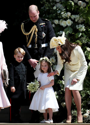 The Duke and Duchess of Cambridge with Prince George and Princess Charlotte leave St George's Chapel in Windsor Castle after the wedding of Prince Harry and Meghan Markle. (Photo by Jane Barlow/PA Images via Getty Images)