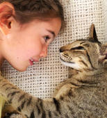 Little girl shares a special relationship with her oriental shorthair