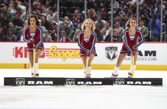 Slide 1 of 5: Members of the of the Colorado Avalanche ice girls clear the snow during a time out against the Minnesota Wild at the Pepsi Center on October 4, 2018 in Denver, Colorado.