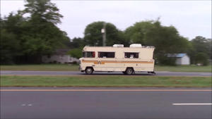 a fire truck that is driving down the road: LS Swapped Winnebago