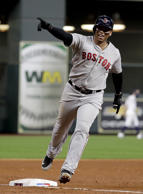 Boston Red Sox's Rafael Devers celebrates his three-run home run against the Houston Astros during the sixth inning in Game 5 of a baseball American League Championship Series on Thursday, Oct. 18, 2018, in Houston. (AP Photo/Frank Franklin II)
