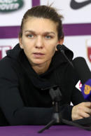 Simona Halep of Romania speaks to the press following the quarter-final round of the Qatar Open tennis competition in Doha on February 16, 2018. Simona Halep pulled out of the tournament earlier in the evening because of a foot injury. / AFP PHOTO / KARIM JAAFAR        (Photo credit should read KARIM JAAFAR/AFP/Getty Images)