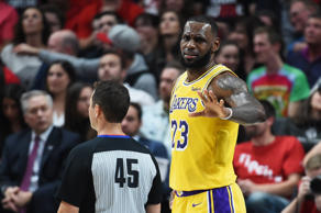 PORTLAND, OR - OCTOBER 18:  LeBron James #23 of the Los Angeles Lakers argues with referee Brian Forte #45 in the second quarter of their game against the Portland Trail Blazers at Moda Center on October 18, 2018 in Portland, Oregon. NOTE TO USER: User expressly acknowledges and agrees that, by downloading and or using this photograph, User is consenting to the terms and conditions of the Getty Images License Agreement.  (Photo by Steve Dykes/Getty Images)
