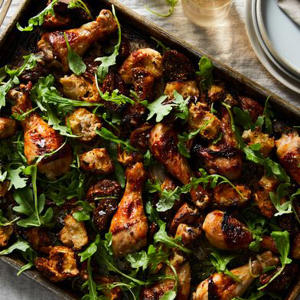 a pizza sitting on top of a pan: Sheet Pan Chicken with Figs and Bread Salad