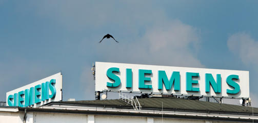 The Siemens logo is pictured at a location in Dresden, Germany, 29 April 2014. The supervisory board of Siemens meets on the same day in Munich to discuss if Siemens will take over French industrial conglomerate Alstom. Photo: Arno Burgi/dpa | usage worldwide   (Photo by Arno Burgi/picture alliance via Getty Images)