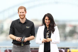Prince Harry, Duke of Sussex and Meghan, Duchess of Sussex watch children control remote control cars during the JLR Drive Day at Cockatoo Island on October 20, 2018 in Sydney, Australia.