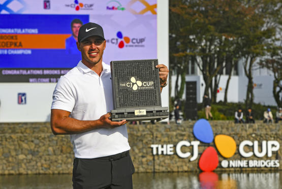 Slide 1 of 93: Brooks Koepka poses with the trophy during the awards ceremony after winning the CJ Cup at Nine Bridges golf club in Jeju Island on October 21, 2018. - Brooks Koepka earned the number one ranking for the first time after claiming his fifth US PGA victory in South Korea on October 21, his round highlighted by a dramatic chip-in birdie on the back nine.