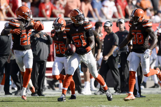 Slide 1 of 18: Cleveland Browns outside linebacker Jamie Collins (51) celebrates an interception during overtime of an NFL football game against the Tampa Bay Buccaneers Sunday, Oct. 21, 2018, in Tampa, Fla.