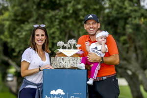 CADIZ, SPAIN - OCTOBER 22:  Sergio Garcia of Spain pose for a photo with his wife Angela Akins Garcia and their daughter after he wins the tournament as the third round resumes play on day five of Andalucia Valderrama Masters at Real Club Valderrama on October 22, 2018 in Cadiz, Spain. The event has been shorted to a 54 hole tournament due to bad weather.  (Photo by Warren Little/Getty Images)