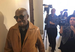 Plaintiff DeWayne Johnson, a school groundskeeper who says Roundup weed-killer caused his cancer, leaves a courtroom in San Francisco, Wednesday, Oct. 10, 2018. A San Francisco judge said in a tentative ruling Wednesday that she would order a new trial in a $289 million judgment against agribusiness giant Monsanto brought by Johnson. (AP Photo/Paul Elias)