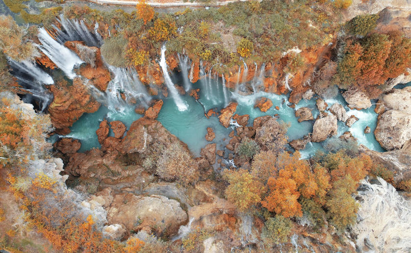 KONYA, TURKEY - OCTOBER 22: An aerial view shows the Goksu Waterfall surrounded by trees with fall colours in Hadim district of Konya, Turkey on October 22, 2018. (Photo by Abdullah Coskun/Anadolu Agency/Getty Images)