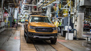a car parked on the side of a building: Ford Ranger Production Start