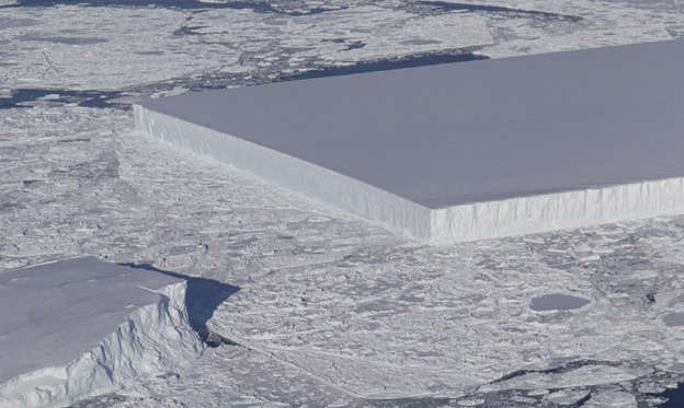 幻灯片 41 - 1: A tabular iceberg can be seen on the right, floating among sea ice just off of the Larsen C ice shelf. The iceberg's sharp angles and flat surface indicate that it probably recently calved from the ice shelf.